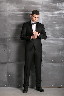 Man in tuxedo in studio