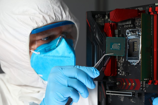 Man in uniform sets microchip electronic equipment