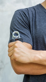 Man use handgrips for exercise.