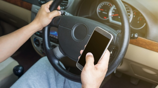 Man use a smartphone in his car.