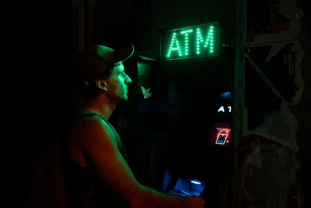 Man using an atm for his money