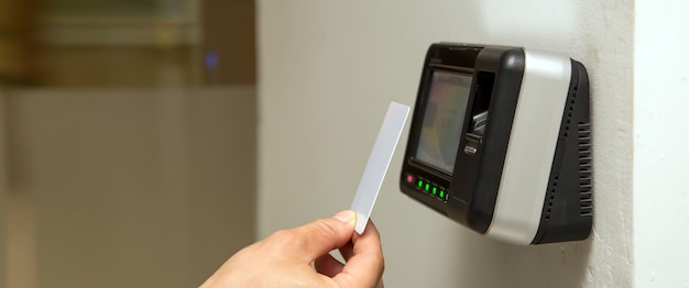 Man using the card to scan at the access control