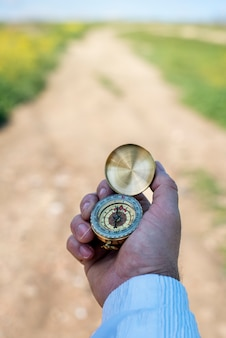 Man using a compass in a field