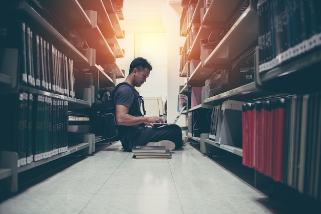 Man using computer laptop in library