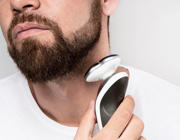 Man using an electric shaver close-up