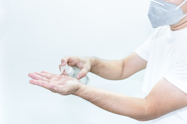 A man using hand sanitizer gel for wash hands to clean stop spreading germs such as coronavirus or covid-19
