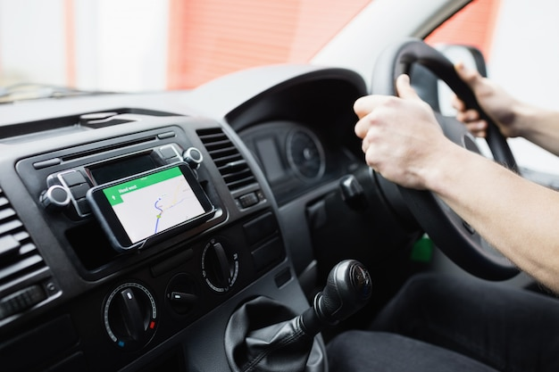 Man using his smartphone as navigation system