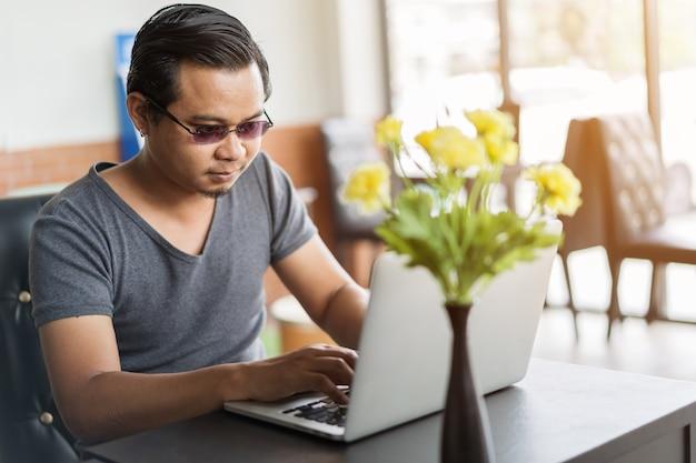 Man using laptop computer in cafe