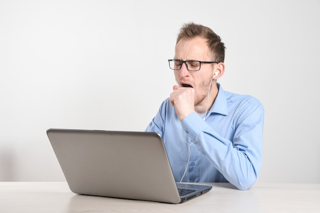 Man using laptop at home in living room. mature businessman send email and working at home.work at home. typing on computer with paperworks and documents on table.
