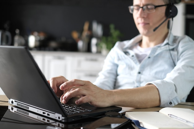 Man using laptop for working online at home