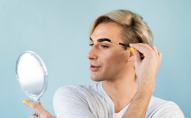 Man using make-up cosmetics