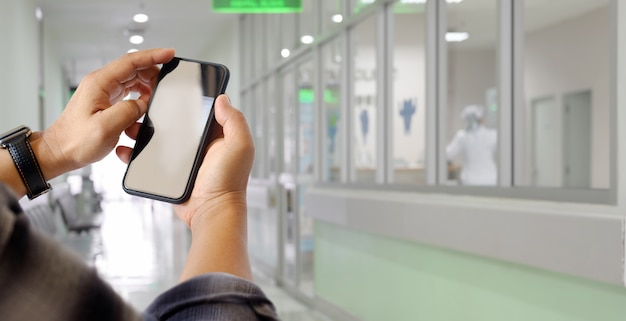 Man using mobile phone in hospital