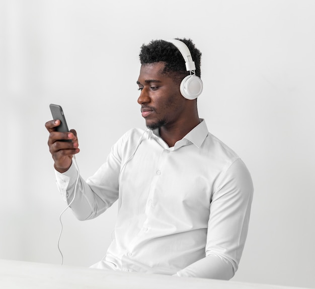 Man using mobile phone and listening to music