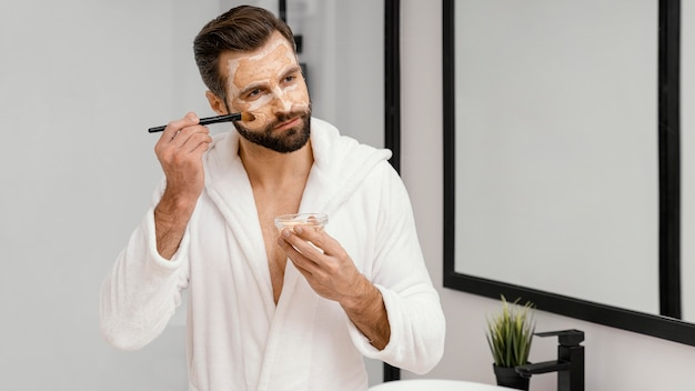 Man using natural ingredients for a face mask