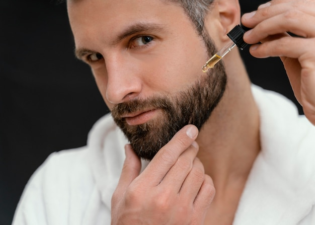 Man using natural oils for his face
