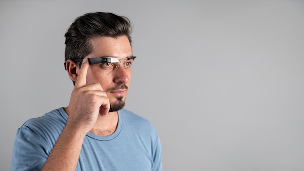 Man using a pair of smart glasses