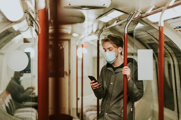 Man using a phone on a train in the new normal