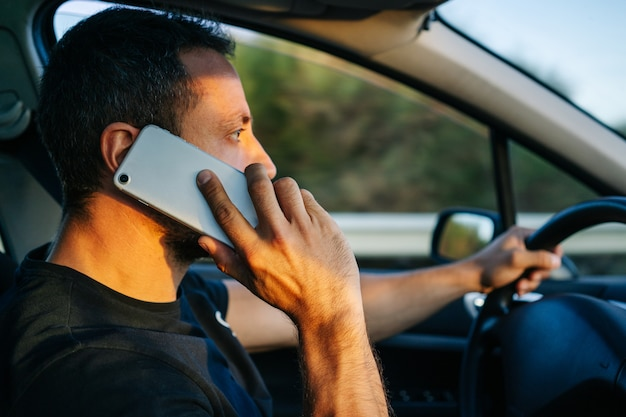 Man using phone while driving