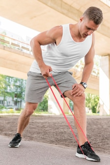 Man using a red stretching band
