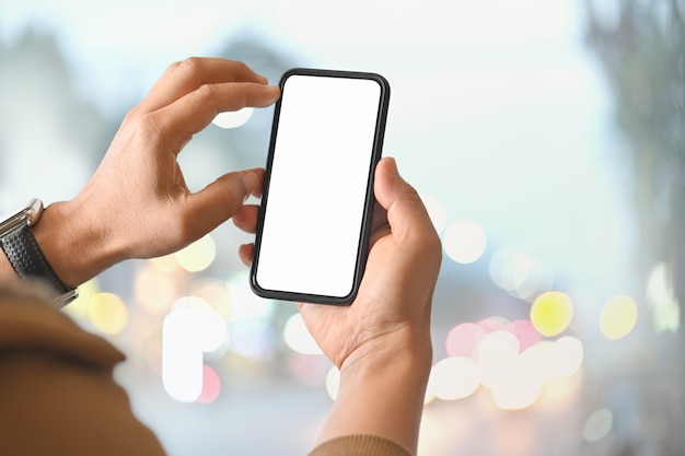 Man using smart phone over blurred bright background