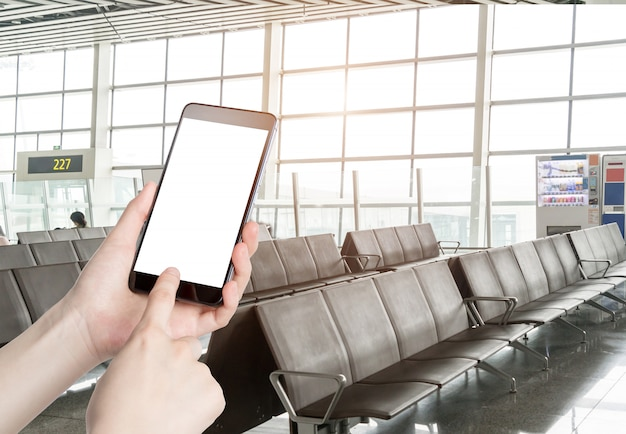 Man using smart phone mobile in the airport terminal