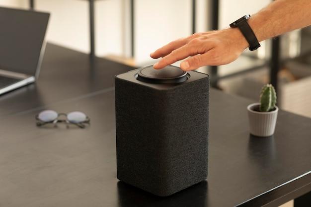 Man using a smart speaker