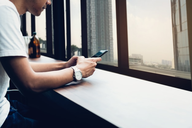 Man using smartphone, during leisure time. the concept of using the phone is essential in everyday life.