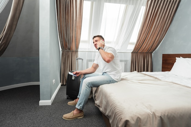 Man using smartphone in hotel room