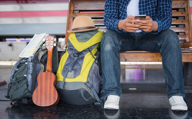 Man using smartphone while waiting train