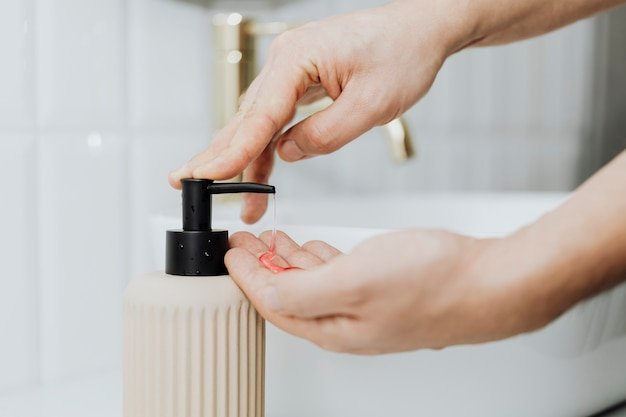 Man using a soap dispenser