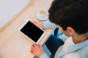 Man using tablet from above