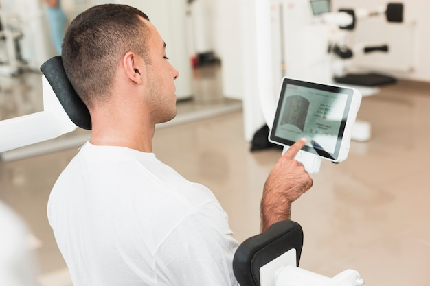 Man using tablet while training