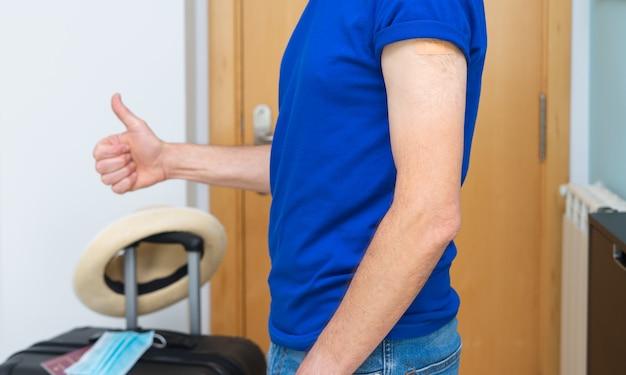Man vaccinated against coronavirus ready to travel.
