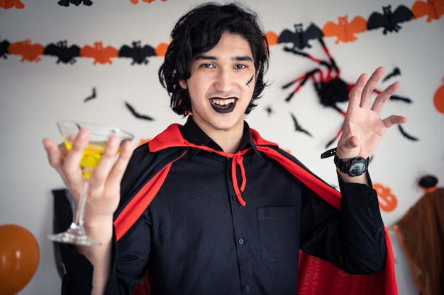 A man in vampires  clothing in halloween party