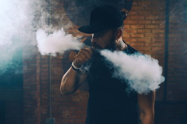 Man vaping an electronic cigarette