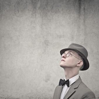 Man in vintage clothes on grey