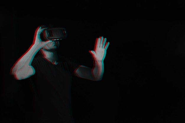 A man in virtual reality glasses is in a simulation.
