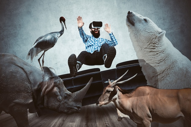 Man in vr glasses, surrounded by virtual animals, virtual world immersion concept