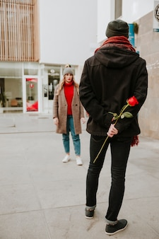 Man waiting girlfriend with rose