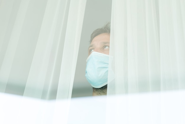 Man waiting in quarantine for covid-19 to stop