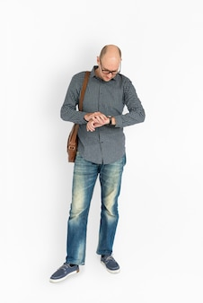 Man waiting to someone and checking the time