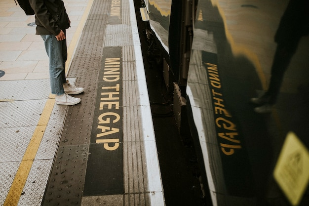 Man waiting for a train on a platform