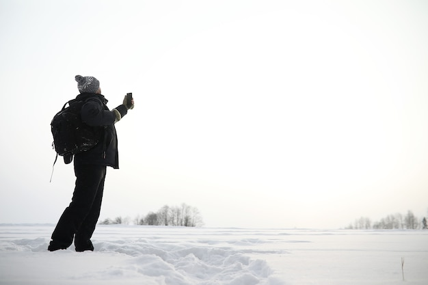 A man on a walk. winter landscape. tourist in the winter journey.