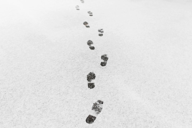A man walked, he left footprints in the snow