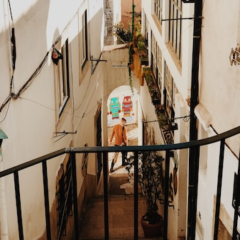 Man walking in alley in lisbon