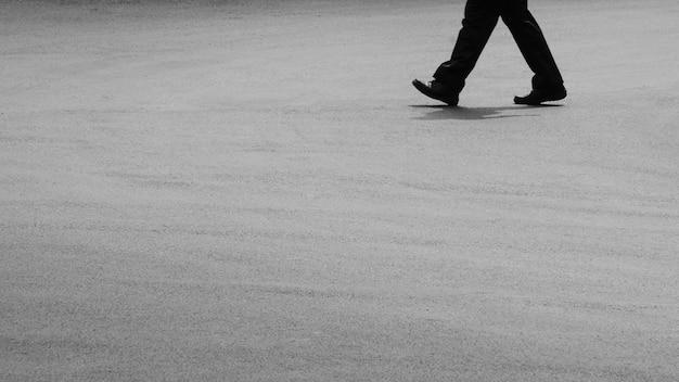 A man walking on asphalt road