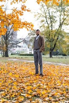Man walking in the autumn park