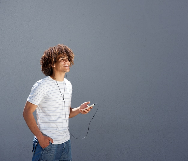 Man walking outside and listening to music with smart phone