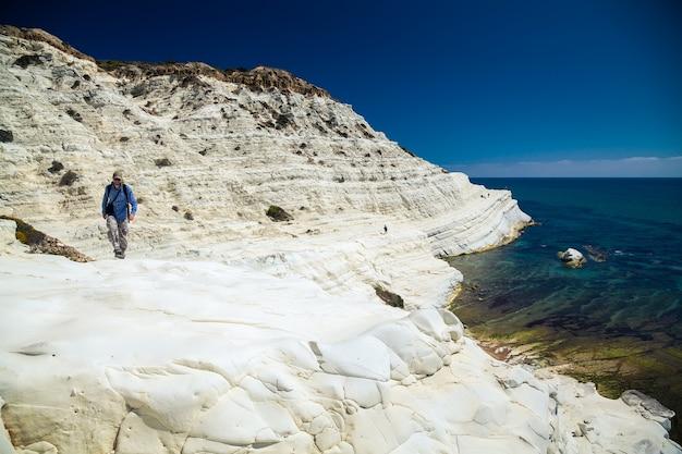 Man walking at the scala dei turchi