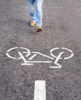 Man walking on separate bicycle lane for riding bicycles breaking rules.